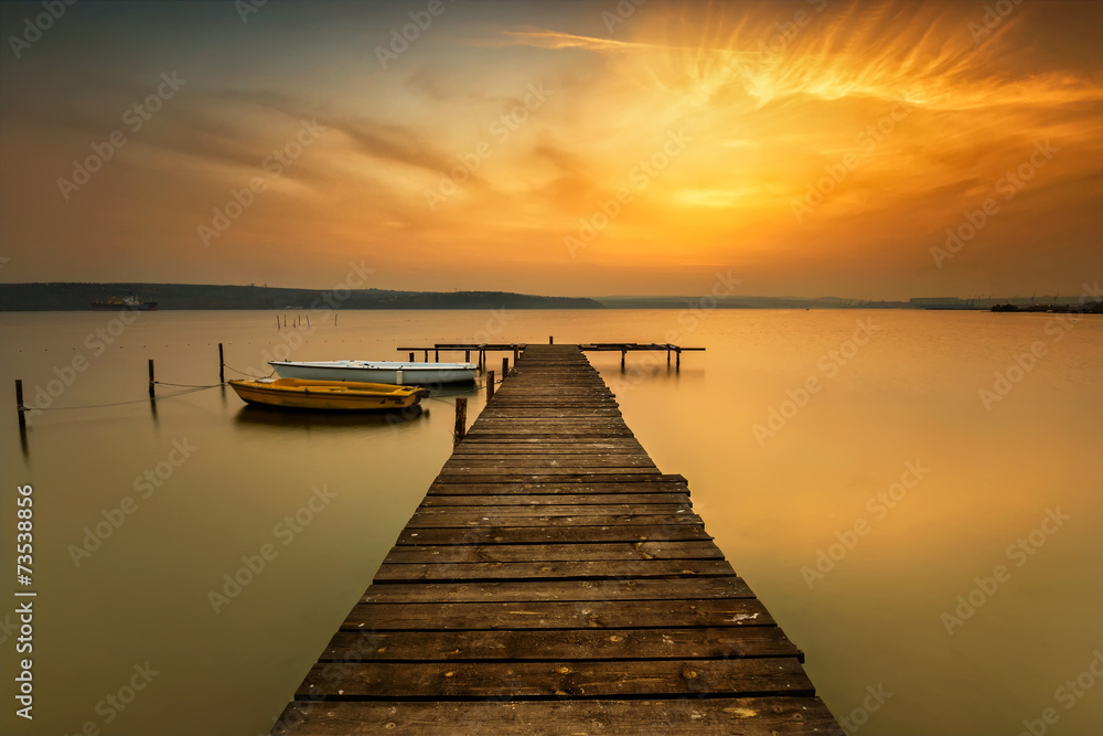 Fototapeta Sunset view with boats at a lake coast near Varna, Bulgaria
