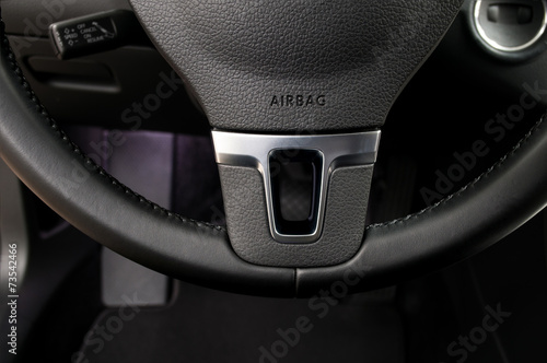 Photo Airbag sign on steering wheel of car. Interior detail.