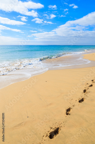 Footprints in sand on Morro Jable beach, Fuerteventura island