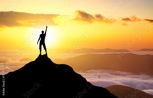 Silhouette of a champion on mountain top Fototapet