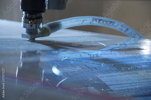 Fotografie, Obraz  engraving machine cuting out pattern