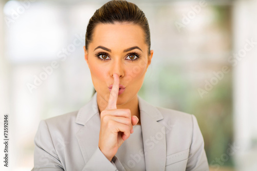 Fotografie, Obraz  young businesswoman saying shhh