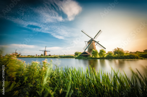 Foto  Historians Dutch windmills near Rotterdam