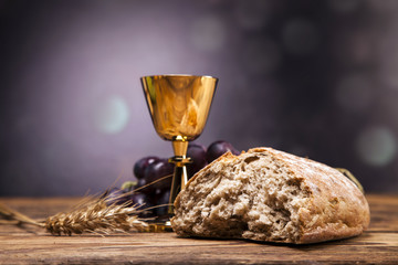 FototapetaSacred objects, bible, bread and wine.
