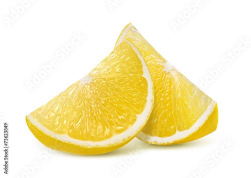 Fotografía  Two fresh lemon quarter slices isolated on white