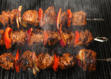 Lamb Kebabs Cooking On Griddle