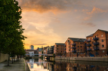 Redeveloped Warehouses Along The River In Leeds At Sunset