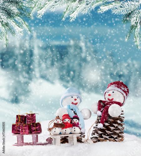 Winter snowy scenery with snow men