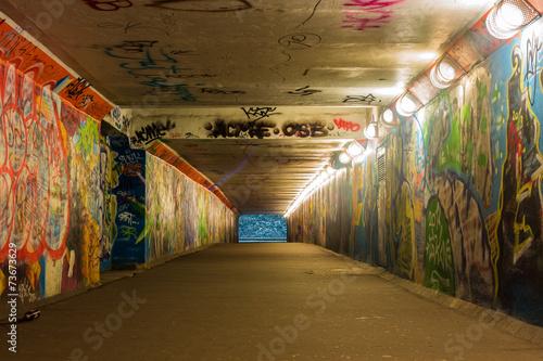 Poster Graffiti Urban underground tunnel with light