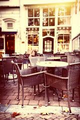 Panel Szklany Do kawiarni Empty street cafe terrace in autumn city