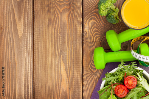 Fotografiet Dumbells, tape measure and healthy food. Fitness and health