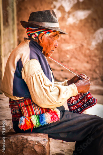Fotografie, Obraz  Old men knitting at taquile island in puno peru