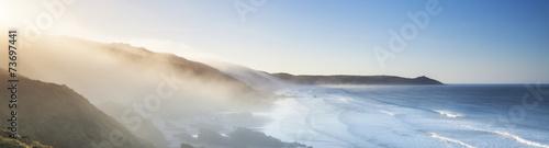 Poster Panoramafoto s Amazing panorama of headland and sea fog at sunrise.