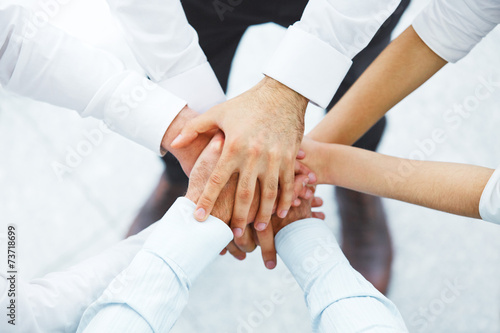 International business team showing unity with their hands toget