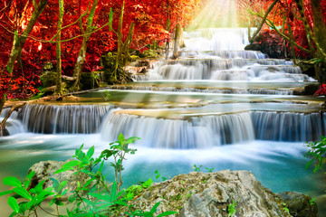 Fototapeta Do biura Beautiful waterfall in autumn forest