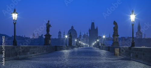 Staande foto Praag blue twilight on Karluv bridge in Prague