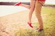 romantic couple kissing on a hot summer beach
