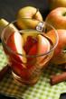 Apple cider with cinnamon sticks and fresh apples