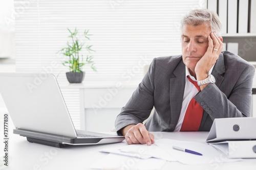Garden Poster Tired businessman falling asleep at desk