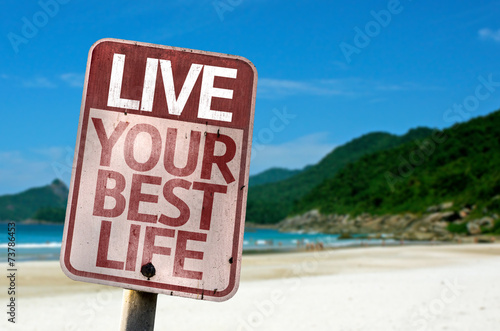 Fotografie, Obraz  Live Your Best Life sign with a beach on background