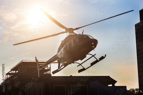 Foto op Plexiglas Helicopter Helicopter Landing on the Pier