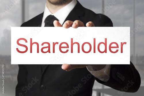Fotografía  businessman holding sign shareholder