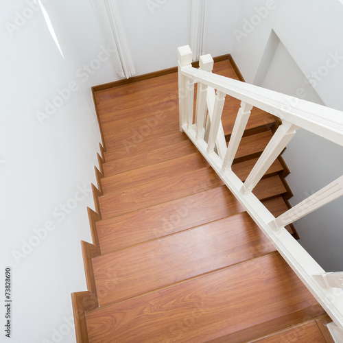 Photo Stands Stairs wooden staircase made from laminate wood in white modern house