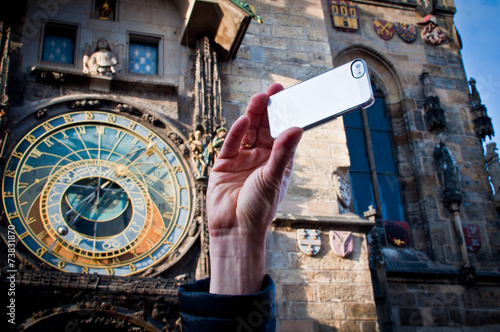 Photo  Taking picture with mobile at Prague clock