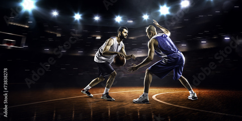 Photo  Two basketball players in action