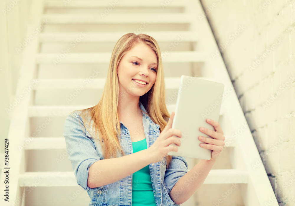 smiling female student with tablet pc computer - obrazy, fototapety, plakaty