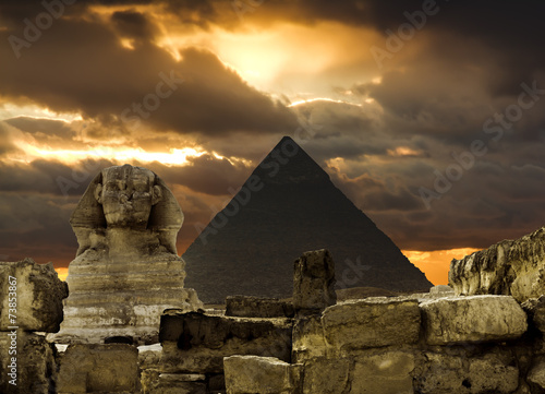 The Sphinx and the pyramid of Cheops in Giza Egipt  at sunset #73853867