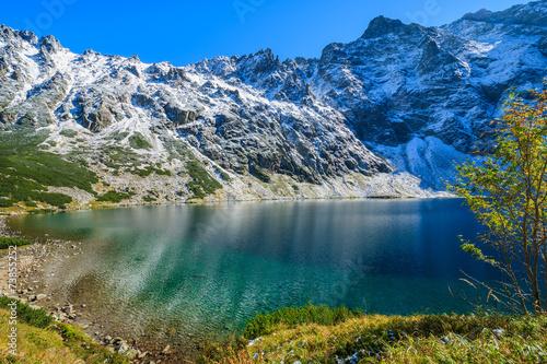 Czarny Staw lake in autumn colours, High Tatra Mountains, Poland