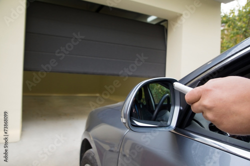 Photo driver opens the garage with remote control