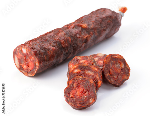 Foto  Iberian sausage cut isolated on white