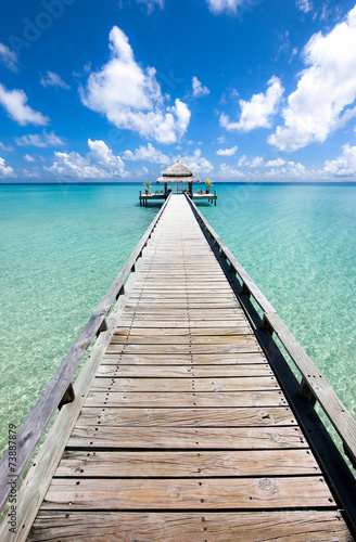 Fotografia  Long pier in the day time, Indian ocean