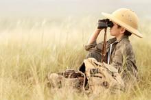 Boy Looking Through Binoculars...