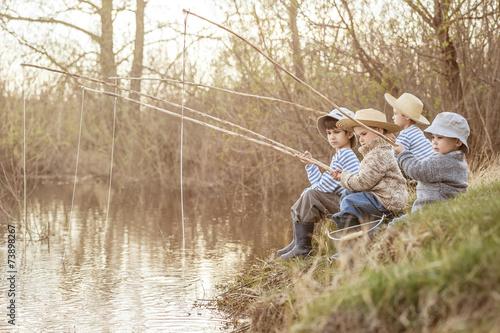 Printed kitchen splashbacks Fishing Boys fishing on the lake