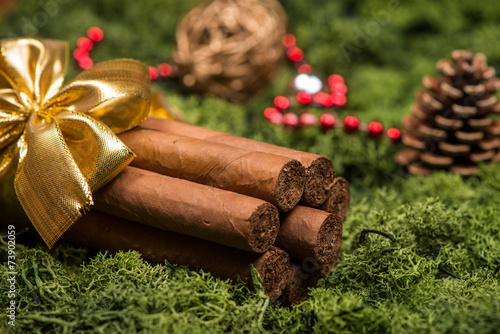 Cuban cigars Christmas gift with golden ribbon and ornaments Canvas Print