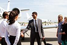 Pilot And Passenger Shake Hands