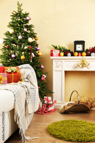 Fotobehang Tuin Beautiful Christmas interior with decorative fireplace and fir