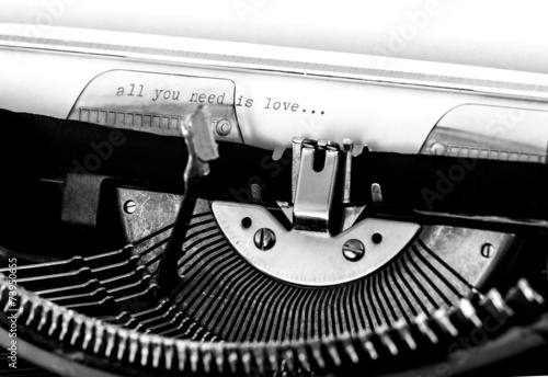 """Photo  Typewriter; """"All you need is love"""" text typed on paper"""