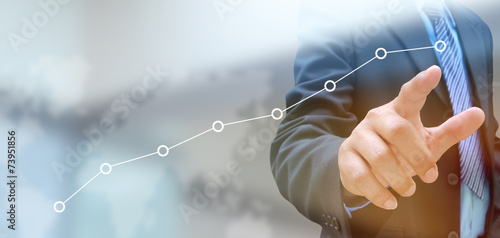 businessman hand pushing a business graph on a touch screen inte