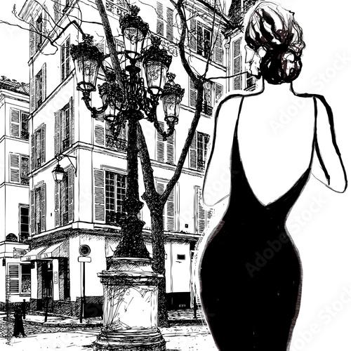 Obraz w ramie Young elegant woman in a black dress