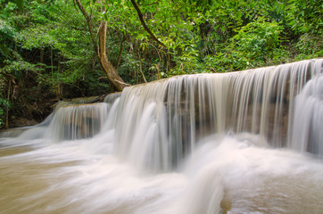 Plakat Waterfall in deep rain forest jungle (Huay Mae Kamin Waterfall i