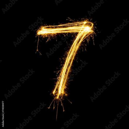 Fotografia  Sparkler firework light alphabet number 7.