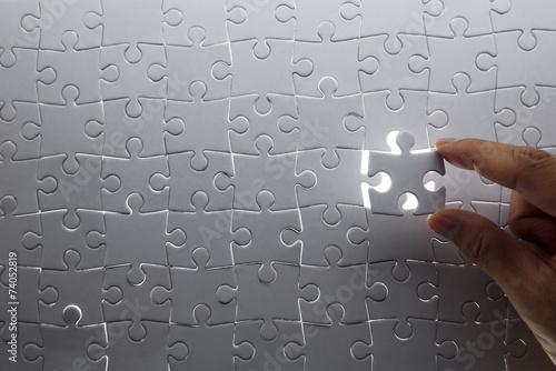 Fotografie, Obraz  puzzle piece coming down into it's place