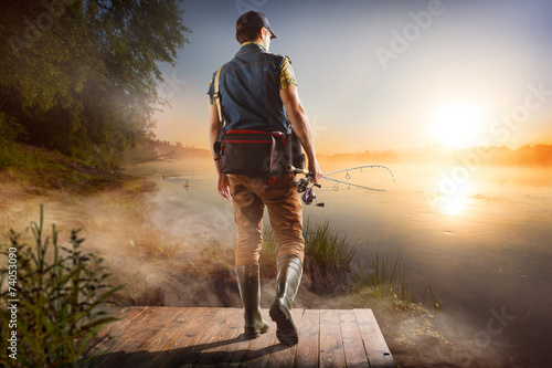 Printed kitchen splashbacks Fishing Young man fishing at misty sunrise