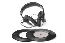 Headphones Arranged Over Some Old 45 Rpm - Stock Image