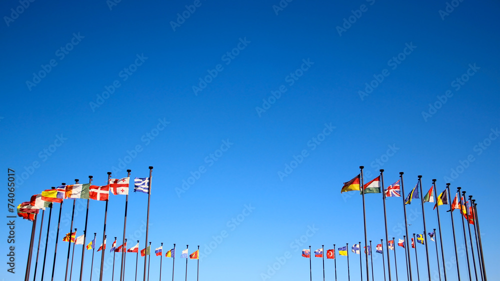 Fototapety, obrazy: international flags against the sky