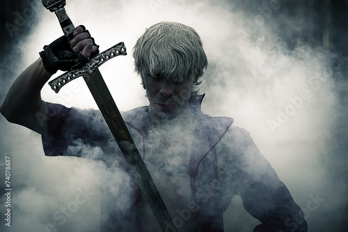 Photo  portrait of a brutal warrior with sword in smoke